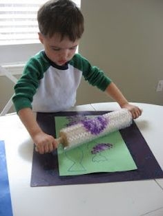 Smart to wrap bubble paper around a rolling pin.  Another preschool idea!