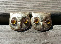 Owl Cloak Clasps, $35. These light weight clasps will keep you company while you're slogging through the woods on a quest or hanging out in the tavern. Solid brass with amber glass eyes; if you like owls you're going to love these! Designed to be a secure closure it can be worn for every day wear, LARPing, Highland games, Renaissance events, rituals, or any other place that you would wear your favorite cloak.