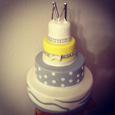 Grey an yellow fondant four tier cake with edible pearls.   Created by Cake Kouture by Char  Denver Co,