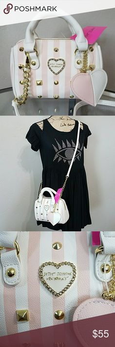 """Betsey Johnson Mini Satchel Crossbody. Betsey Johnson Mini Satchel Crossbody. Cute little number, perfect for running errands or a night out. Blush & White vertical stripes and golden studs, comes with detachable pink and white heart charm. White strap with golden chain is also detachable. Zipper closure.Please note tiny scratch on one side of the heart charm in last picture. Measures approx. 7""""1/2 L at bottom x 3""""1/4 W at bottom x 5"""" H. Feel free to ask any questions before. Bundle & Save…"""