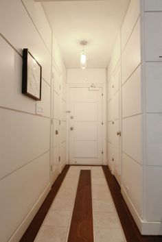 | z | horizontal boards create a quiet beckoning.   a view at the end of the corridor would enhance the progression