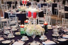 Rope-wrapped centerpieces are standout at this nautical wedding. Photography courtesy of 5ive15teen Photo Company.