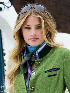 The Kelly green blazer is beautiful with the scarf tied around the neck.  Great makeup and hair.
