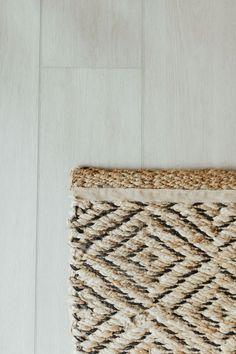 Geometric jute rug with LVP flooring Unique Flooring, Vinyl Plank Flooring, Sheepskin Rug, Luxury Vinyl Plank, Jute Rug, Cool Rugs, Nordic Design, House Tours, Area Rugs