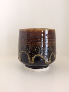 Black yunomi with tea dust by fellow pinner Annie Jennings