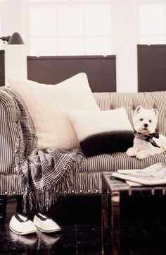 Curl up with the newspaper and a friend on a Ralph Lauren Home black and white striped tufted sofa