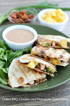 Grilled BBQ Chicken and Pineapple Quesadillas with BBQ Ranch Dipping Sauce.. I would do without the pineapple
