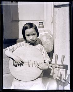 Asian Girl with Stringed Instrument - from the collection of Underwood & Underwood Glass Stereographs (1895-1921). From the Archives Center of the National Museum of American History.