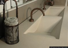 Sonoma Cast Stone's Concrete Wave Sink. Voted Best New Product of the Year by 40,000 kitchen and bath professionals at the National Kitchen and Bath Show. No shape is better-suited to the public restroom than this undulating wave. Sinks slope neatly to the drain.