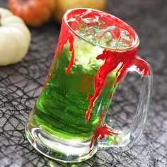 Blood Green Brew - This blood green brew is actually a thirst-quenching purchased lemon-lime pop in disguise. The bloody mug only adds to the fright level of this Halloween beverage. Holidays Halloween, Spooky Halloween, Halloween Treats, Happy Halloween, Halloween Decorations, Halloween Party, Halloween Recipe, Halloween Cupcakes, Holiday Treats