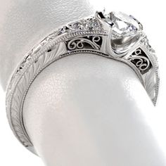 Unique Engagement Rings in Omaha. Hand engraved vintage inspired ring with filigree and  half bezel setting in Omaha.