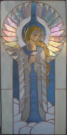 Gothic Prayer Angel. Just to be fair we designed this angel for Lynde and it hangs proudly in her home. The irrid glass makes her magical.