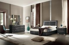The ALF Versilia contemporary bedroom set in real Koto grey stained wood veneer, with a high gloss UV finish. One of Italy's newest designs to come from ALF Italia, This bed comes available in all sizes, and has the additional option of lit headboard & underbed storage. Complete the look with full sizes dresser , 5 drawer chest and nightstands.