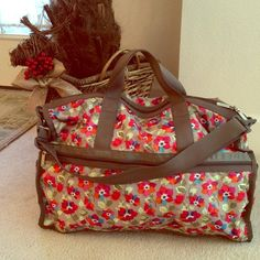 LeSportsac Vibrant Floral Weekender Bag Great take on a weekend duffle bag. Gray background with vibrant pink, orange and blue flowers. Outside and top zippers. Inside is white, as seen in photo four. Excellent condition! Retired pattern. Perfect for vacation, university, work, anything! LeSportsac Bags Travel Bags