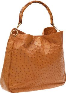 My 1999 Cognac Gucci Bamboo Handle Hobo Bag is like this but soft leather, not ostrich.