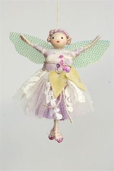 Halinka's Fairies..The Lilac Fairy The last fairy is the Lilac fairy ( wisdom ) and of course she has a lilac coloured dress over laid with ivory lace and trimmed with green lilac leaves. She measures 8cm tall