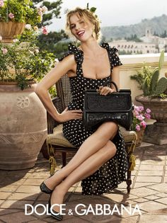 I love everything about this Dolce & Gabbana outfit. The polka dots, the bag -- even the ad's setting makes me happy!