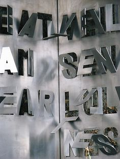 Cut and bent metal text in London