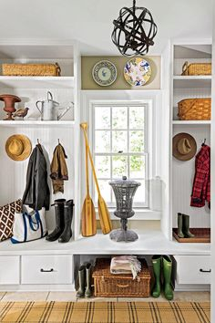 "Mudroom - 2015 Charlottesville Idea House Tour - Southernliving. ""No one in my house ever actually hangs up a coat. They just drop it on a hook,"" says Bunny, who installed six hooks and two cubbies that line the back hall—turning the hallway into a bona fide mudroom."