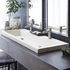 The Trough 4819 Drop-In Sink is a sensible solution for eco-conscious bathrooms. The raised edge assures water stays in the sink, while the long rectangular shape provides plenty of space for multiple users.