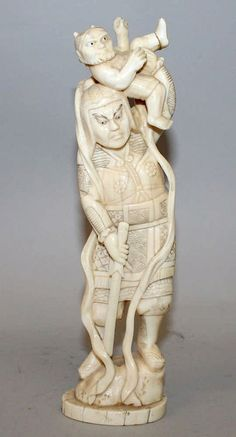 AN EARLY 20TH CENTURY JAPANESE CARVED IVORY FIGURE OF SHOKI THE DEMON QUELLER, standing on a rockwork base and holding an oni above his head, 8.75in high.