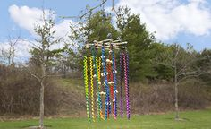 Dye and glitter pasta to add a vibrant, sparkling wind chime to the porch for springtime!