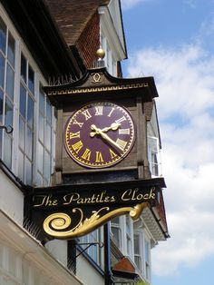 ENGLAND..... Tunbridge Wells. The beautiful Pantiles n' a gracious ice clock sits above the row of cases and shops........,