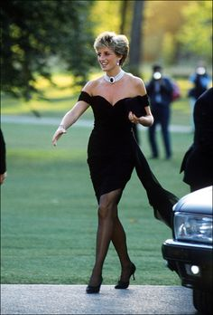 "Princess Diana in Revenge Dress, 1994 | Princess Diana's ""Revenge"" dress was by Christina Stambolian, and was purchased for a Vanity Fair dinner at the Serpentine Gallery. The black silk dress had an asymmetrical bodice and came to be known as the ""revenge"" dress because she wore it on the same day her ex-husband, Prince Charles, admitted to marital infidelities. The dress sold for $ 74,000 at auction in 1997."