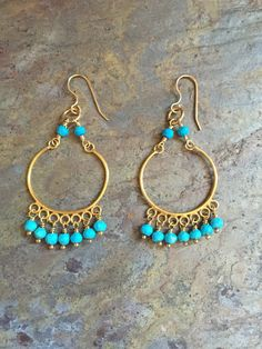 A personal favorite from my Etsy shop https://www.etsy.com/listing/467284475/turquoise-chandelier-gold-earrings