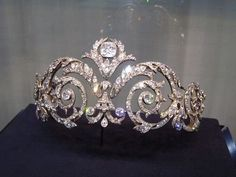 A belle epoque tiara, 1908, by Chaumet. Made for the Marquis de Talhouet, a classic scrolling foliate tiara, with large circular diamonds at the centre of each scroll and topped by a larger, cushion-cut diamond.