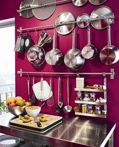 Love the idea of using towel racks with hooks to hang pots/pans and slipping the lids behind.