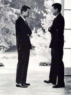 Kennedy brothers Robert and President John F. Kennedy outside the White House