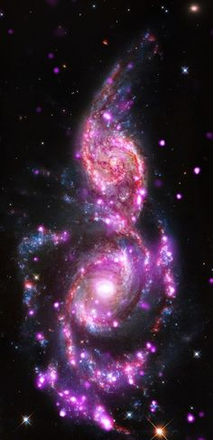 Merging Galaxies Bursting With Light - NGC 2207 and IC 2163 Just like our Milky Way galaxy, NGC 2207 and IC 2163 are sprinkled with many star systems known as X-ray binaries, which consist of a star in a tight orbit around either a neutron star or a stellar-mass black hole.