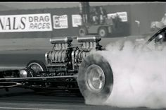 John Peters behind the haze of the infamous Freight Train dragster. Tony Nancy with his Steve Swaja- designed,Plymouthwedge-powered dragster.