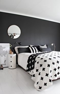 Black feature wall, striking geometric bedding and a few well chosen accessories - chic and cheerful . . .