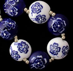 Handmade Organic Lampwork GlassWedge Beads by debbiesanders. They aren't cheap, but her level of detail seems to be well worth it. #supplies