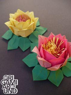 http://origamiaround.tumblr.com/post/165684821978/origami-flower-arrangements