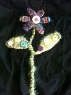 Flower - made with yarn, wire and embellishments