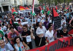 DEMONSTRATORS MARCH with Palestinian flags during a protest against the Israeli offensive against Gaza, in Valencia, Spain Photo By:…