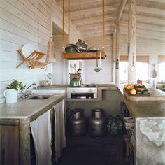 wood pot rack hung with rope, also dish drainer attached to the walls