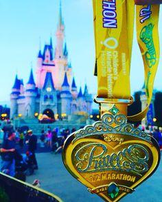 Disney princess half marathon 2016 medal in front of Cinderella's Castle