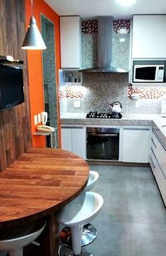 Bela cozinha projetada por Regina Segura.