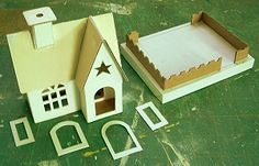 Howard Lemay's patterns for little houses. They are wonderful patterns to help recreate vintage style Putz houses.