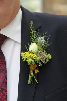 Flower Design Buttonhole & Corsage Blog: Beautiful Wild Flower Boutonnieres Tied With Wool