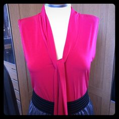 Tie-neck jersey top What a yummy top! Bright pink, with a deep V and a tie that can hang loose (as pictured) or turned into a bow for a different look!  Banana Republic Tops