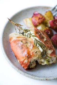 Goat Cheese Stuffed Rosemary Chicken in Prosciutto- This dish is surprisingly easy to make and is SO so good!! Great when you need to cook a dish to impress. │ bbritnell.com