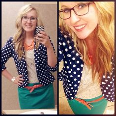 Green skirt, navy polka dot blazer, cream top, coral belt and necklace. Modest fashion