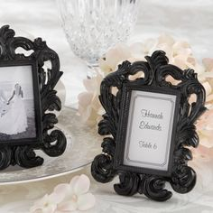 We could buy very cheap frames and paint them black or silver.  Black Baroque Wedding Place Card Holder and Photo Frame