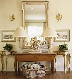 Perfectly symmetrical design is the height of traditional design. And what better way to welcome guests into ones home than with a beautiful display of perfection as shown here? The French walnut table is showcased by two wonderfully distressed cen Country House Interior, Home Interior, Interior Design, Interior Modern, Kitchen Interior, French Country Cottage, French Country Style, French Farmhouse, Modern Country