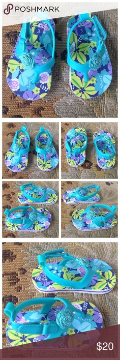 Carter's Blue Floral Toddler Sandals 3 Carter's. Super cute blue floral multicolor sandals. Flower on top with Velcro closure. Toddler size 3. Look brand new. Carter's Shoes Sandals